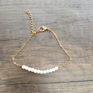 Brand new gold bracket with pearls.